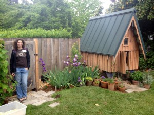 Megan Conca in front of the Redwood Tudor chicken run; photo by Mica Habarad.