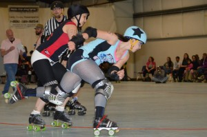 Sick Town jammer Ill Ninja breaks deflects a hit; photo by Tim Berg.