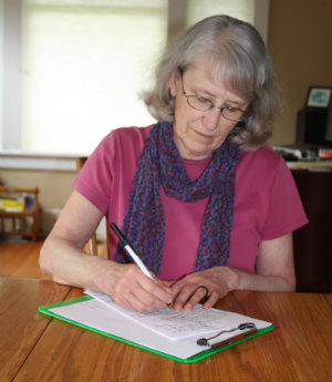Annette_writing_at_table