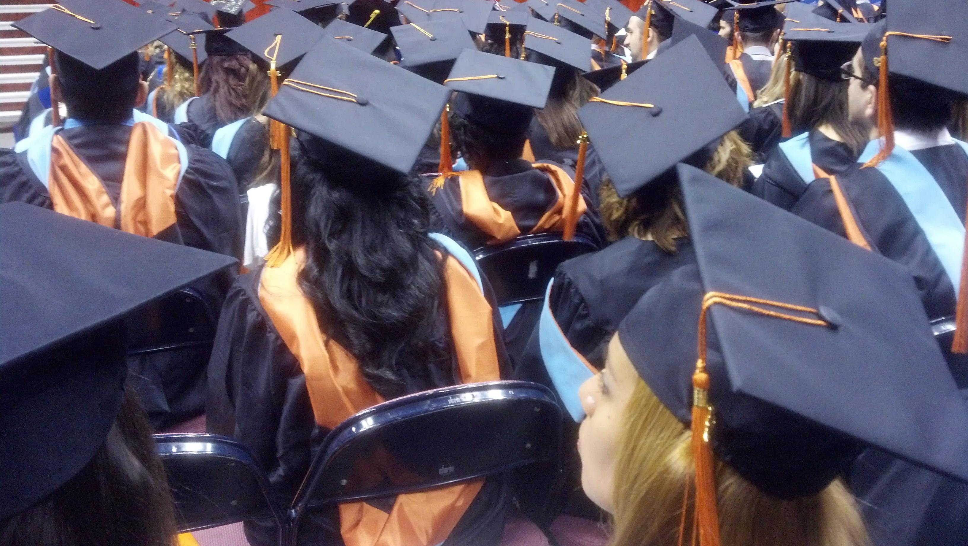Graduates sit at ceremony