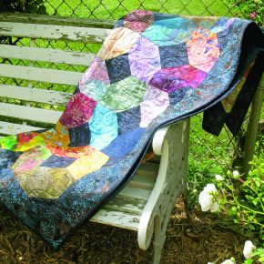 quilt on a bench
